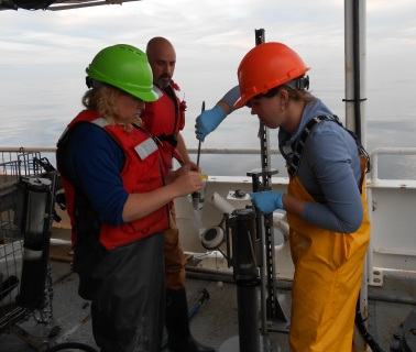 Out on deck sampling one of our cores on the R/V Wacoma during the UNOLS Early Career Training Cruise in 2011.